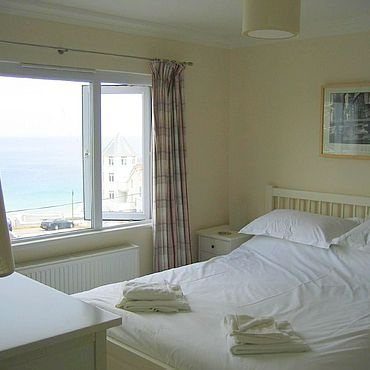 The master bedroom is ensuite and has views of Porthmeor beach
