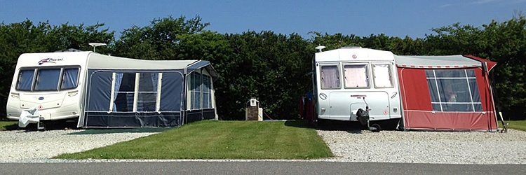 Spacious individual caravan pitches with parking alongside