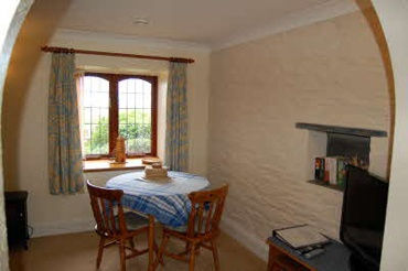 Lower Mills cosy sitting room and dining area