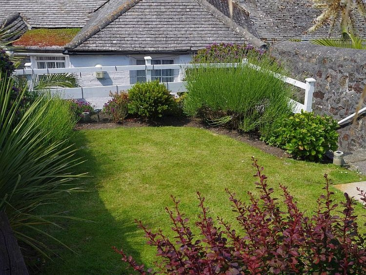 The lawned garden at Porth Enys